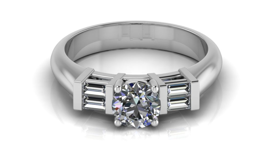 White gold engagement ring featuring a round diamond with side baguettes