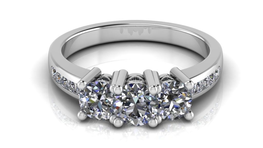 White gold three stone engagement ring with channel set diamonds down the band and side heart motifs