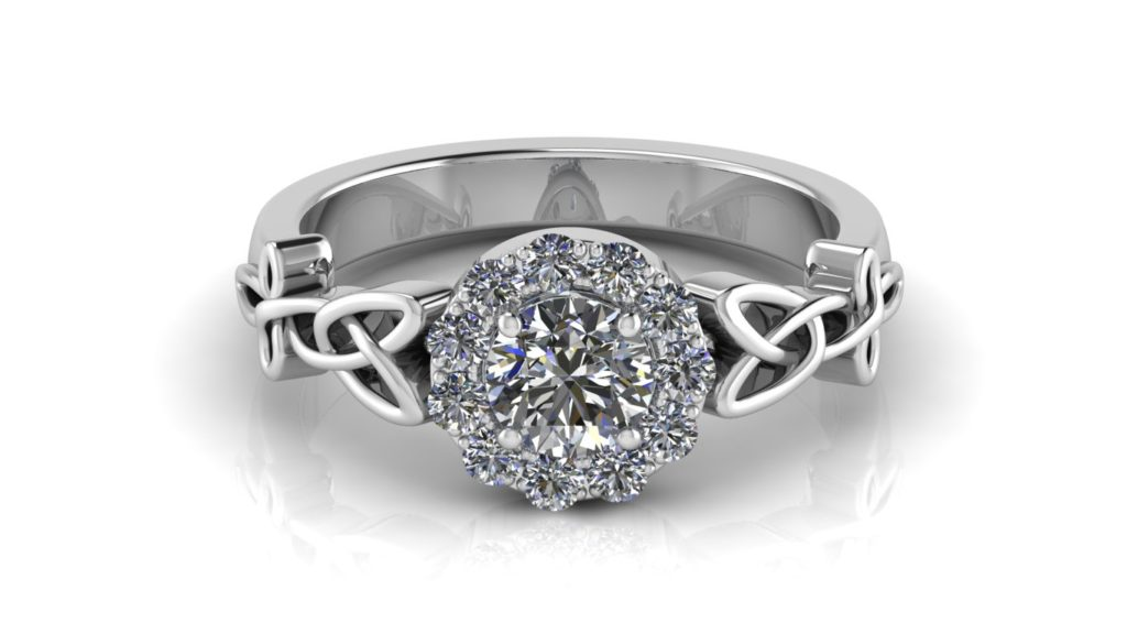 White gold celtic knot halo engagement ring featuring a claw set round diamond