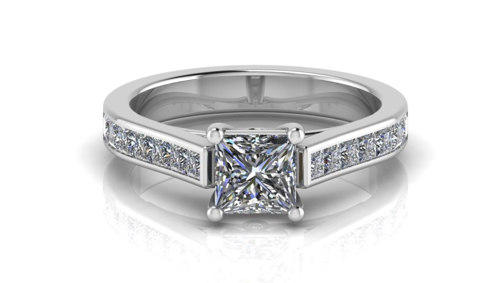 White gold engagement ring featuring a claw set princess cut diamond with channel set princess cuts down the band