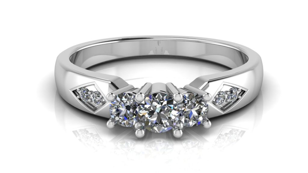 White gold three stone engagement ring with smaller accent diamonds set in a diamond shape motif