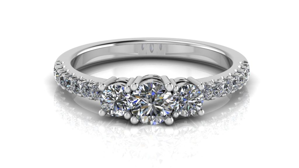 White gold three stone diamond engagement ring with accent diamonds down the band