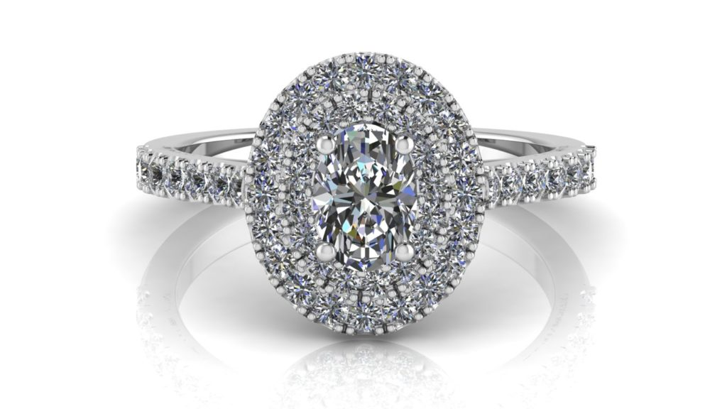 White gold double halo engagement ring featuring an oval cut diamond with smaller diamonds down the band
