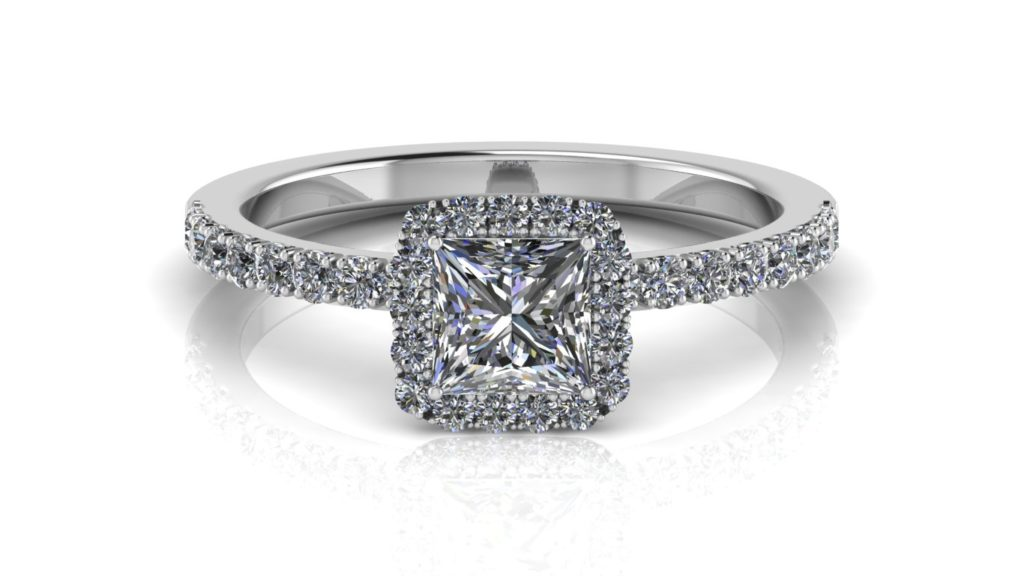 White gold halo engagement ring featuring a princess cut diamond with smaller diamonds down the band