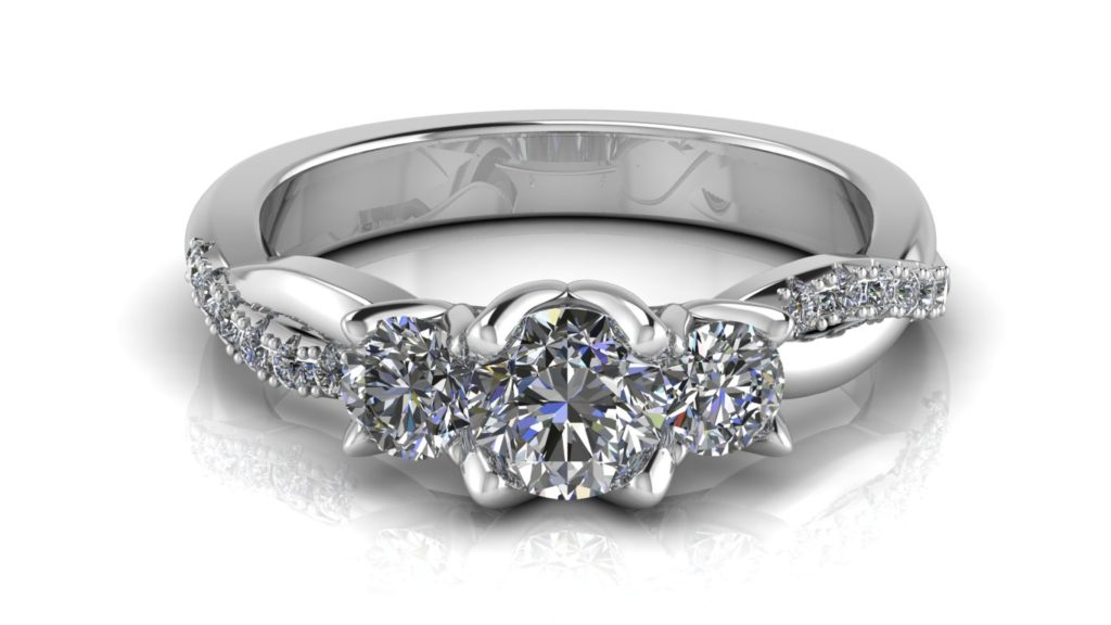 White gold three stone engagement ring with smaller diamonds down a twisted band