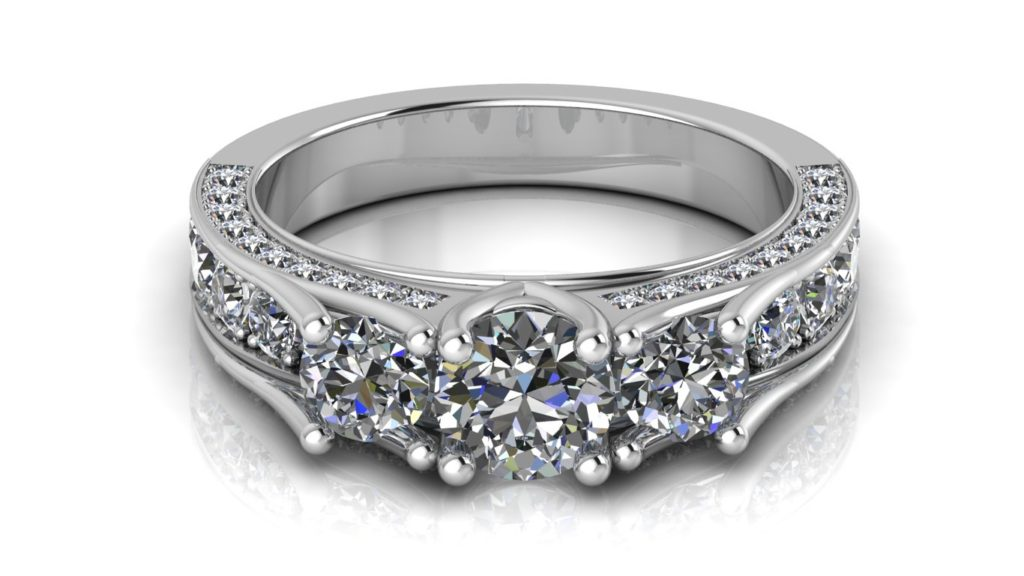 White gold three stone engagement ring with pave set diamonds down the band and sides