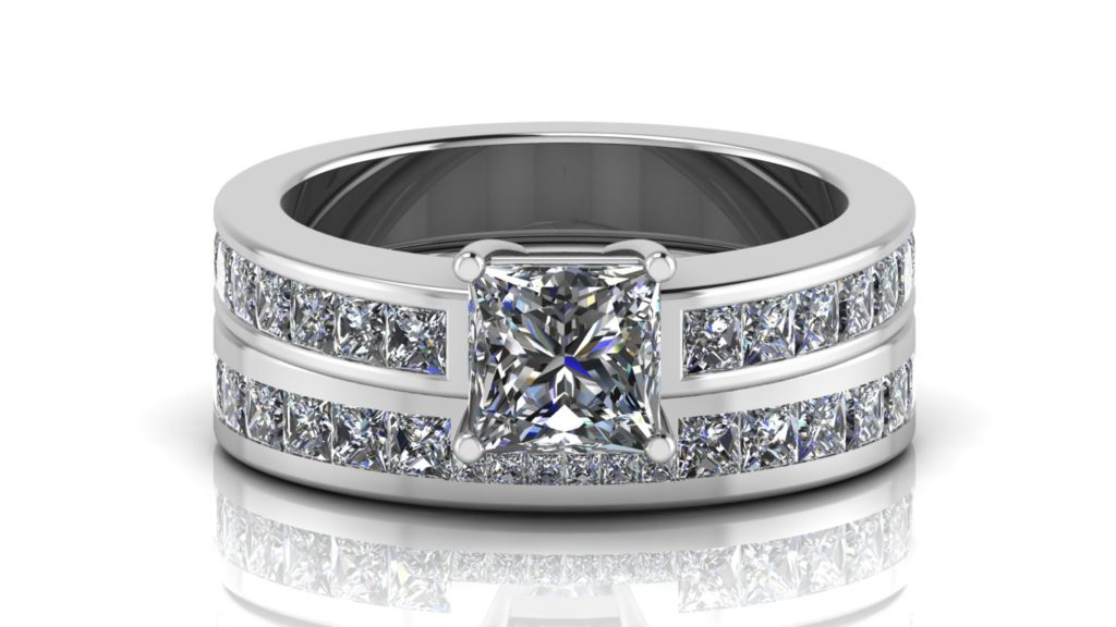White gold engagement and wedding band featuring a claw set princess cut diamond and smaller channel set princess cuts