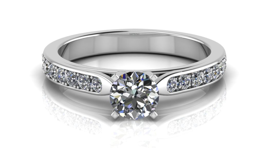 White gold engagement ring featuring a round diamond with pave set diamonds down the band