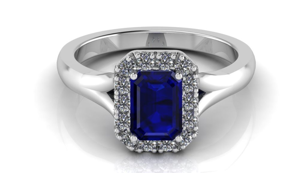 White gold split shank halo engagement ring featuring an emerald cut ceylon sapphire and diamonds