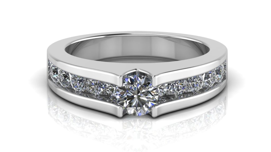 White gold engagement ring featuring a round diamond with channel set diamonds down the band