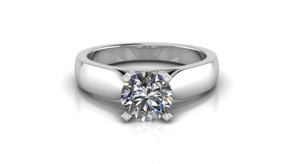 White gold solitaire engagement ring featuring a round diamond