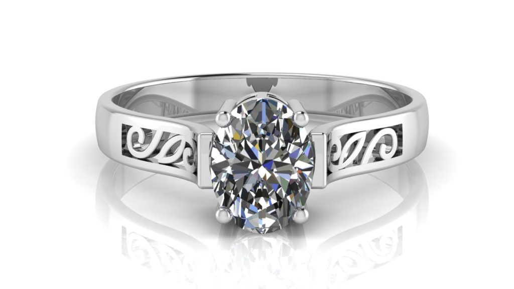 White gold engagement ring featuring an oval cut diamond with scroll work accents