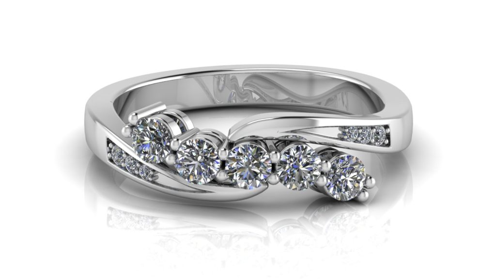 White gold bypass engagement ring featuring five round diamonds and smaller accent diamonds