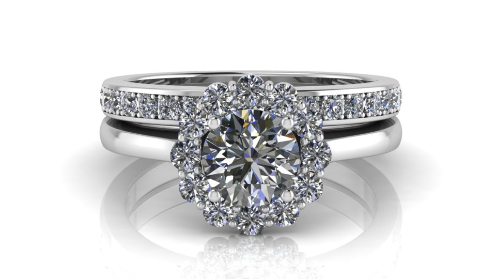 White gold flower halo engagement ring featuring a round diamond and pave set diamond wedding band