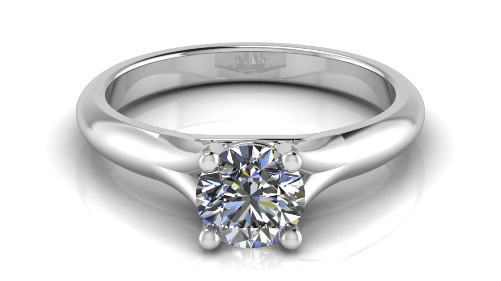 White gold split shank solitaire engagement ring featuring a round diamond
