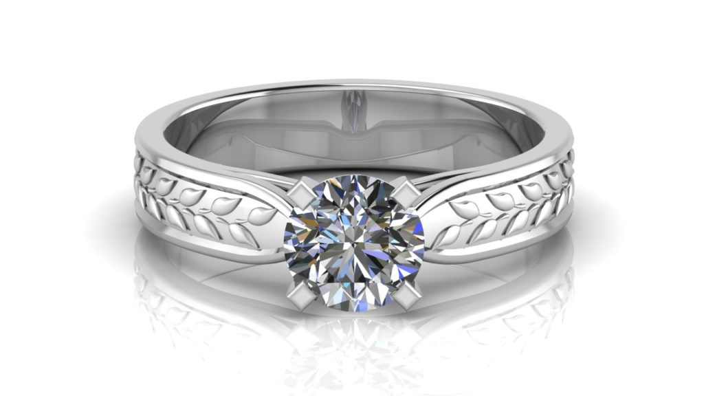 White gold solitaire engagement ring featuring a round diamond with leaf motifs