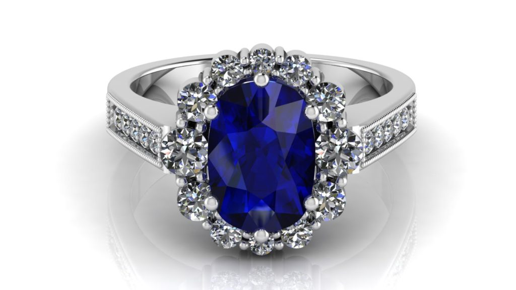 White gold halo engagement ring featuring a cushion cut ceylon sapphire with diamonds and milgrain accents