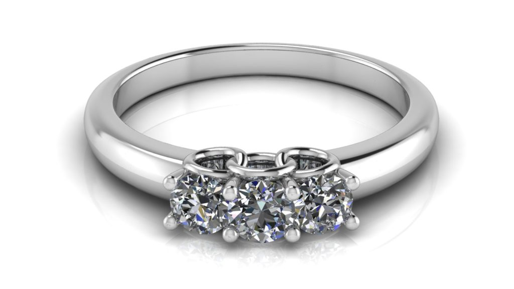 White gold three stone engagement ring with side circle motifs