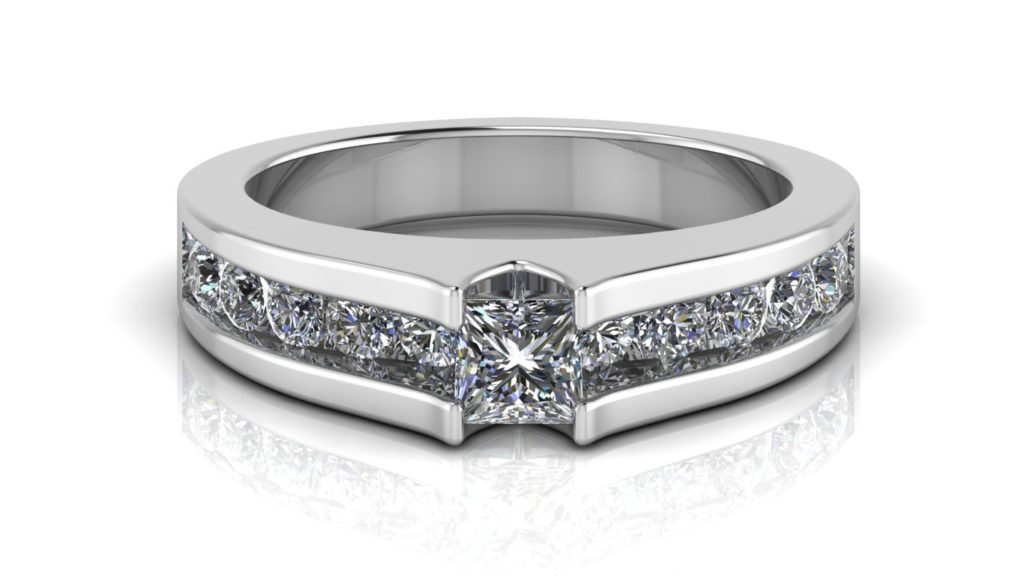 White gold engagement ring featuring a princess cut diamond with channel set diamonds down the band