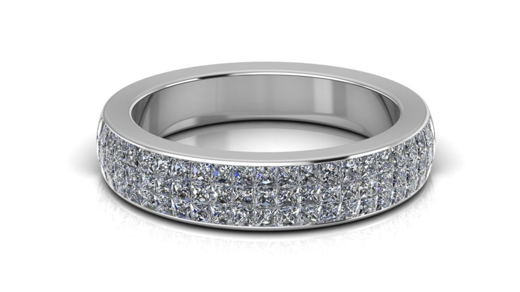 White gold illusion set ring with princess cut diamonds