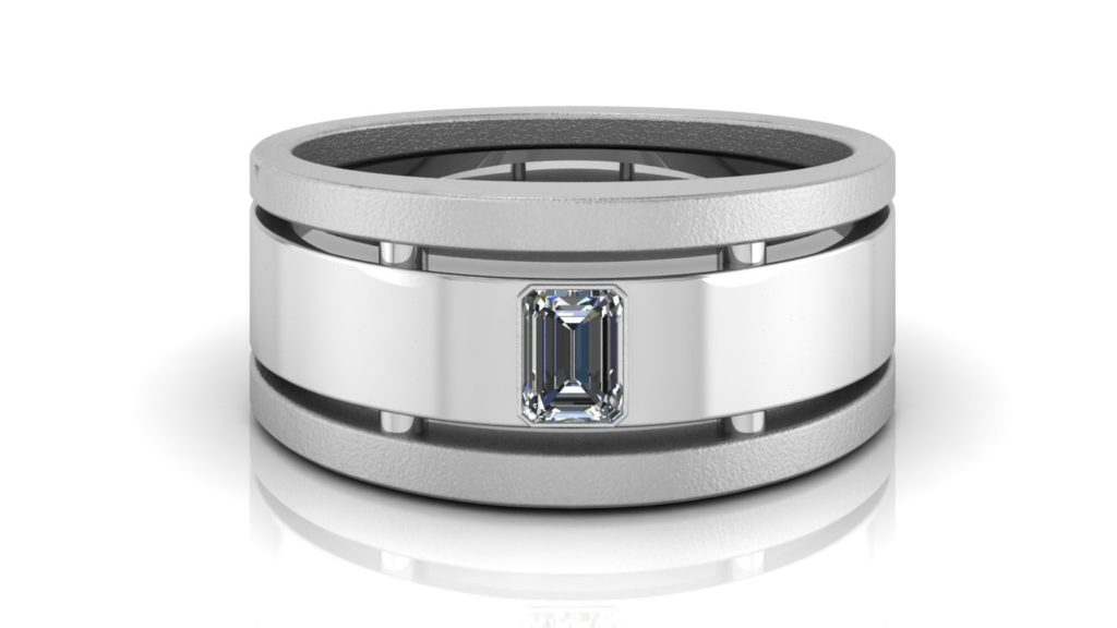 White gold wide mens band featuring a bezel set emerald cut diamond with textured side accents