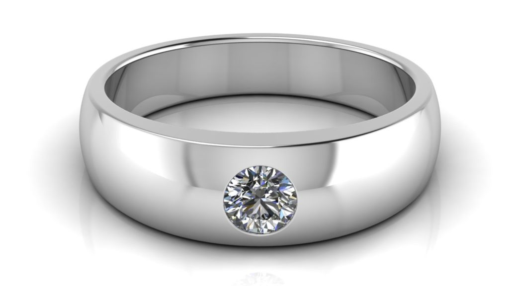 White gold band featuring a flush set round diamond