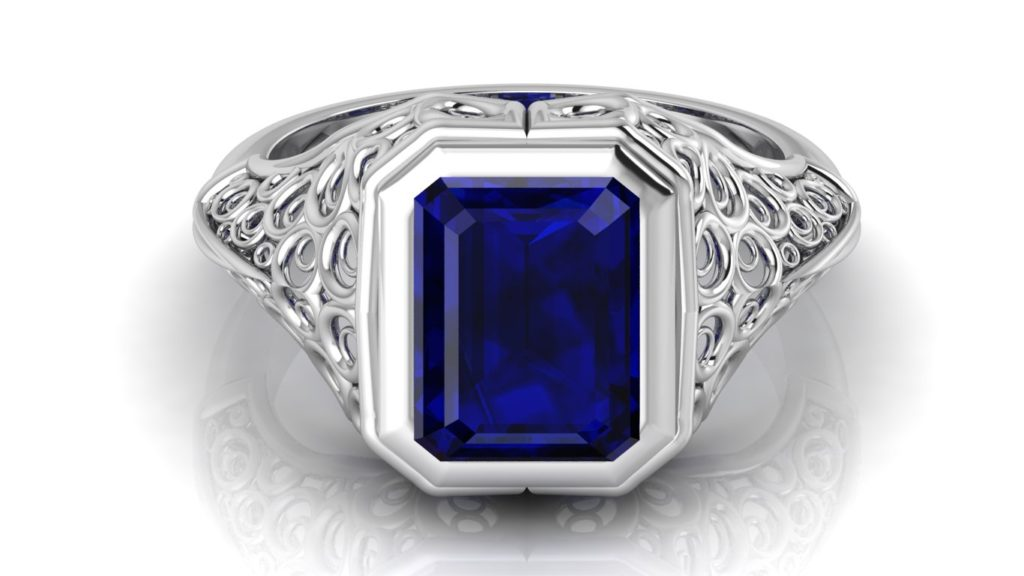 White gold filigree signet style ring featuring an emerald cut ceylon sapphire