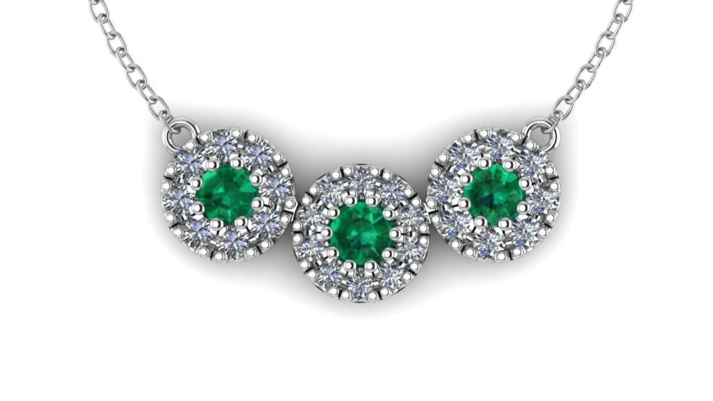 White gold triple diamond halo pendant featuring emerald
