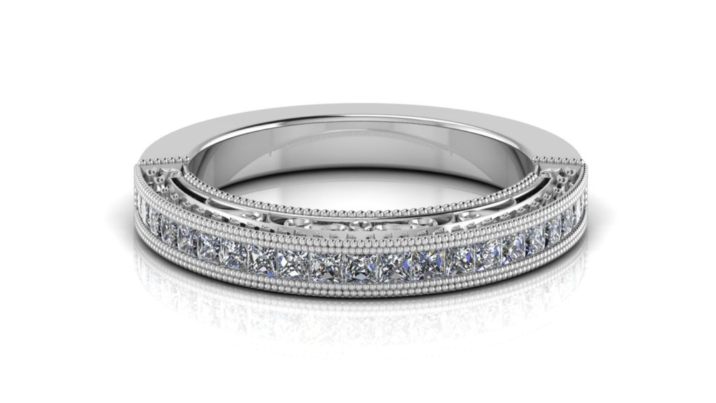 White gold ladies ring featuring channel set princess cut diamonds with milgrain accents and side scrolll work