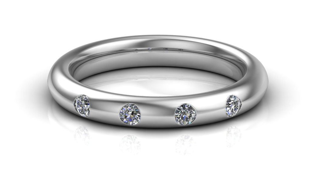 White gold ladies band featuring four flush set diamonds