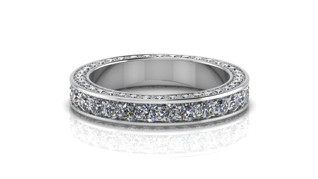 White gold ladies ring featuring pave set diamonds with smaller side diamonds
