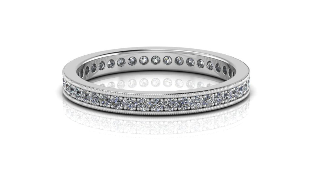 White gold ladies eternity ring featuring pave set round diamonds with milgrain edges