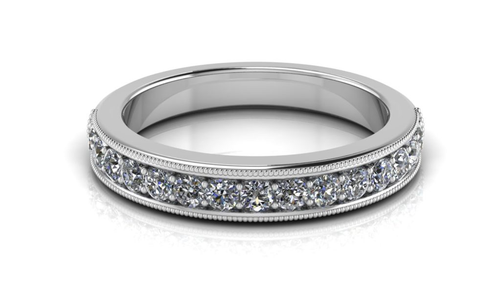 White gold ladies ring featuring pave set diamonds with milgrain accents