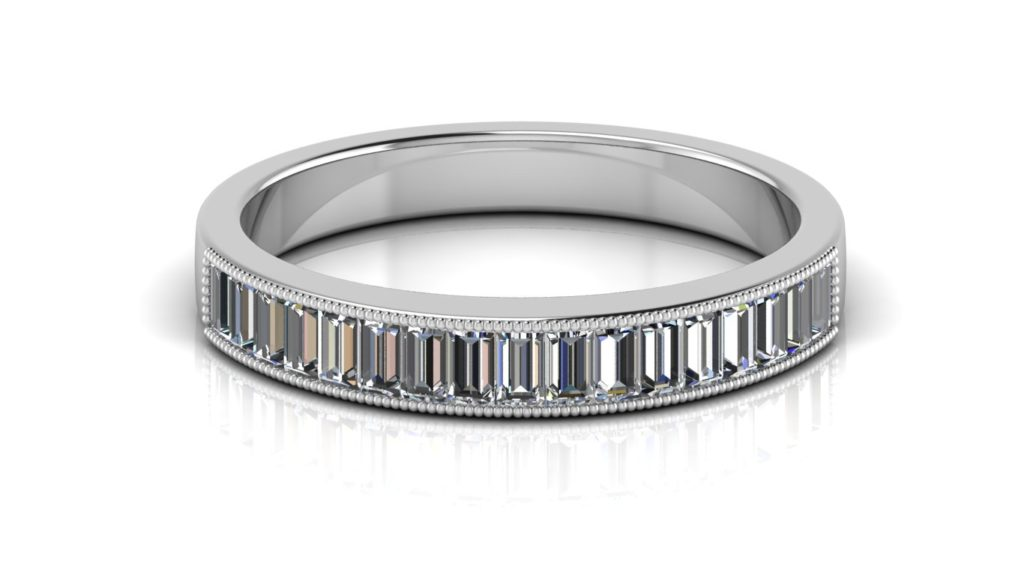 White gold ladies ring featuring channel set baguette diamonds with milgrain accents