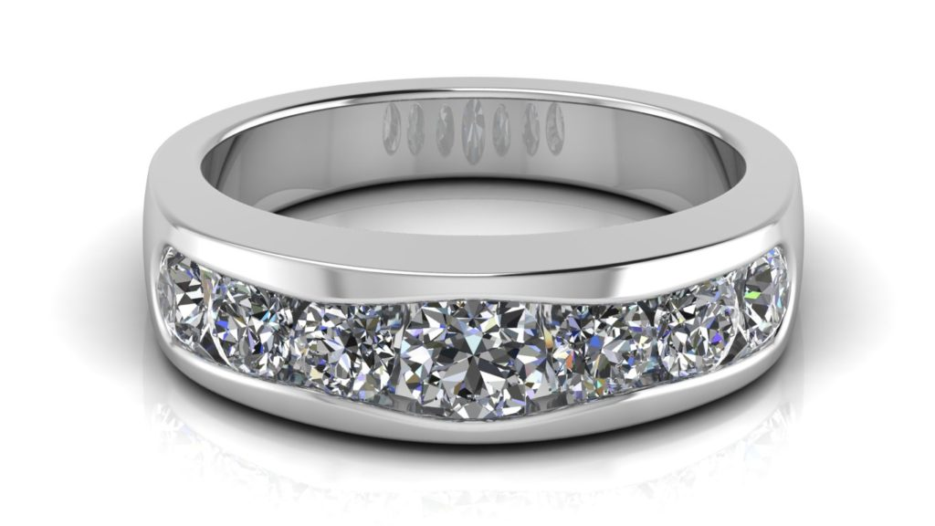 White gold ladies band featuring channel set diamonds of graduating size