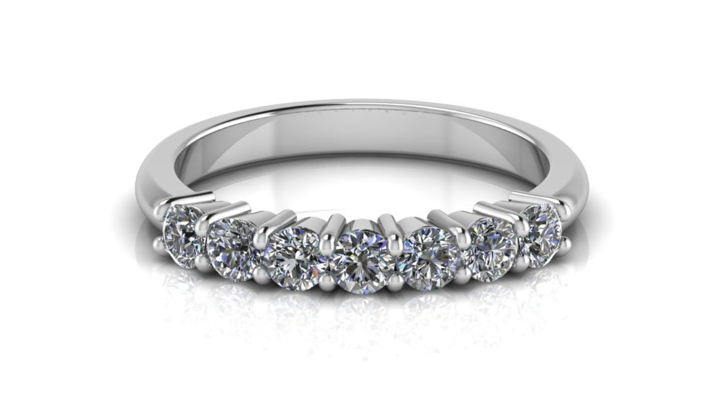 White gold ladies share claw ring featuring seven diamonds