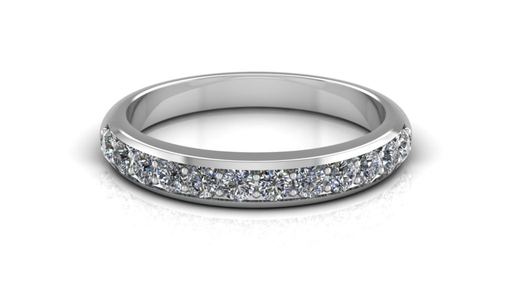 White gold ladies ring featuring pave set diamonds