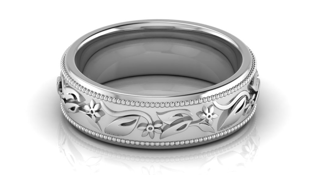 White gold ladies band with floral motif center and milgrain edges