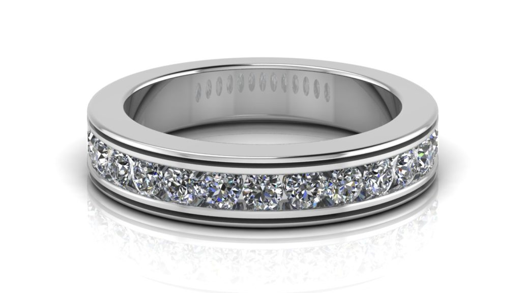 White gold ladies ring featuring channel set diamonds with groove accents